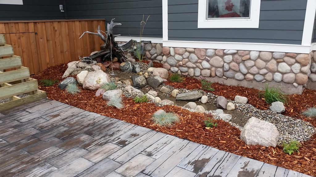 Water feature and paver walkway